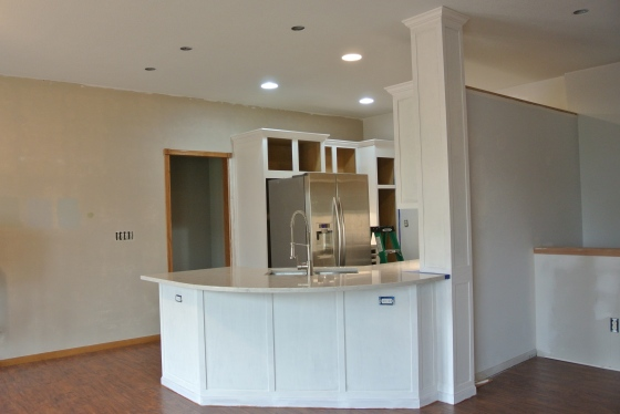 The kitchen cabinets - primed and painted!