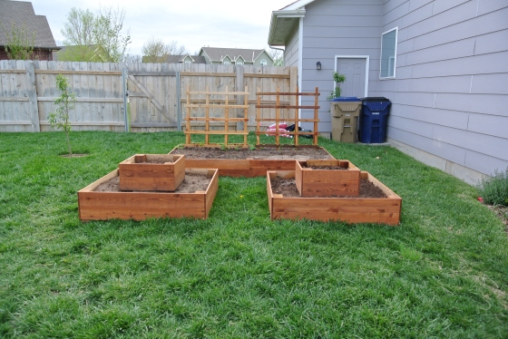 The cedar planting beds are ready to be filled with plants.
